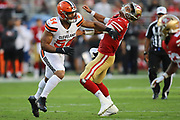 Cleveland Browns defensive end Olivier Vernon (54) gets a hand in the face of San Francisco 49ers quarterback Jimmy Garoppolo (10) during an NFL football game, Monday, Oct. 7, 2019, in Santa Clara, Calif. The 49ers defeated the Browns (Peter Klein/Image of Sport)