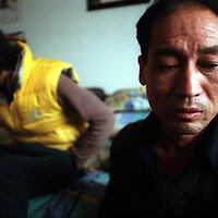 BEIJING,11/20/2000: Song Pengfei and his father sit disillusioned in their small apartment at the end ofthe day. While Song's father continues to raise attention for his son's disease, Song Pengfei admits that he feels tired of telling outsiders about his life..Song's China's no.1 AIDS activist. When he spoke out for the first time during an AIDS sumit in Singapore, Chinese officals refused to shake hands with him , saying he was a shame for China. As times have changed however, Song was allowed to meet former US president Bill Clinton in 2003. Today he's one of the few HIV postive patients who have access to western HIV treatment and he's invloved in several volunteer projects.
