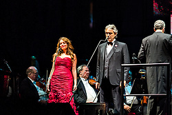ANAHEIM, CA - JUN 9: Italian tenor Andre Bocelli performed Granada, New York, La Boheme, La Traviata among others keeping audience mesmerized at the Honda Center in Anaheim, CA. The magical night included producer David Foster on Piano, Violinist Caroline Campbell, American Idol Season 3 winner Soul Singer Fantasia, Cuban Soprano Maria Aleida and Orchestra Conductor Eugene Kohn. Cuban Soprano Maria Aleida (L) sings with italian tenor Andre Bocelli (C) and conductor Eugen Kohn (R). All fees must be agreed prior to publication, Byline and/or web usage link must  read  PHOTO: SilvexPhoto.com
