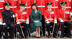 © Licensed to London News Pictures. 17/03/2012. Aldershot, UK. The Duchess of Cambride CATHERINE (KATE) MIDDLETON presenting traditional sprigs of shamrock to the 1st Battalion Irish Guards at Mons Barracks in Aldershot, Hampshire, UK, on Saint Patrick's Day, March 17th, 2012.. Photo credit : Alison Baskerville/LNP