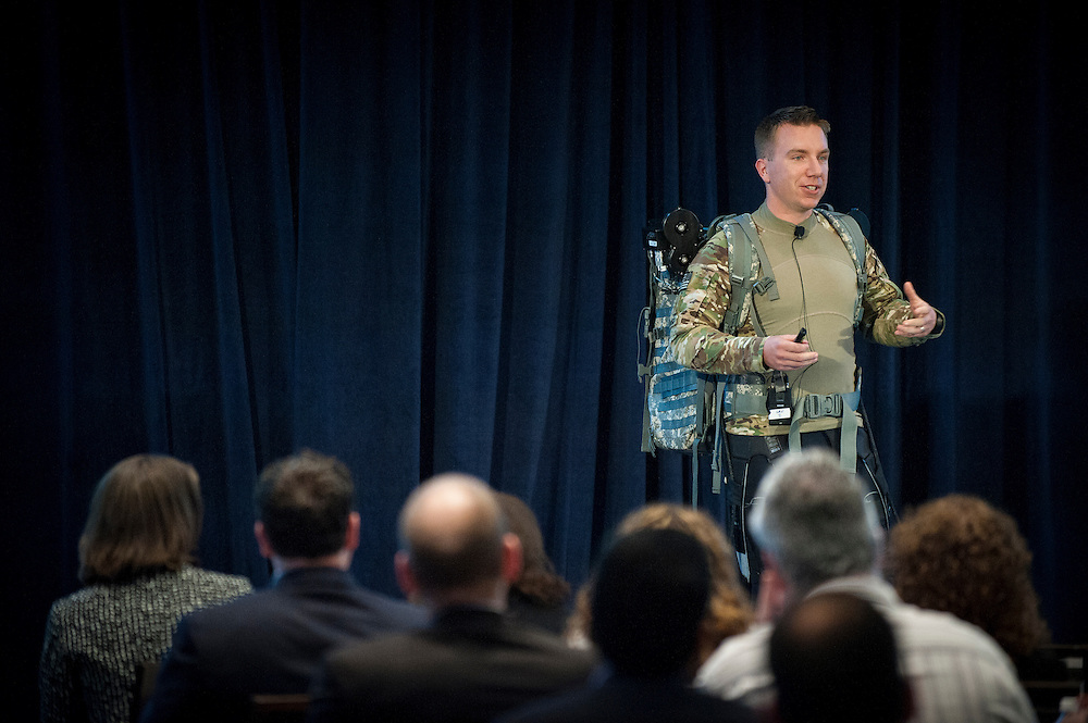 MAJ Chris Orlowski, Program Manager in DARPA's Tactical Technologies Office, discusses his work to develop a soft suit that can be worn by troops to prevent injury and reduce the metabolic load of carrying heavy equipment. The talk was part of a two-day event held by DARPA's Biological Technologies Office to bring together leading-edge technologists, start-ups, industry, and academic researchers to look at how advances in engineering and information sciences can be used to drive biology for technological advantage.