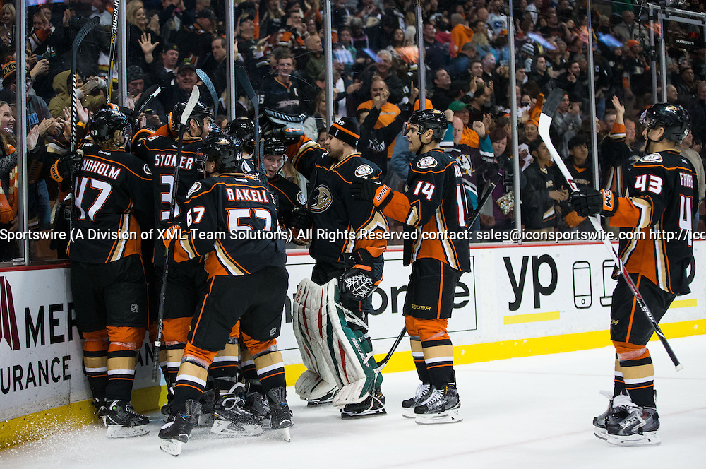 December 28, 2014 - Anaheim Ducks celebrate after defeating the Canucks in overtime 2-1 during the game between Vancouver Canucks and Anaheim Ducks at Honda Center in Anaheim, CA. Ducks defeated Canucks in overtime 2-1.