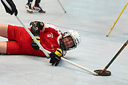 Graz, Austria - 2017 March 23: Tomasz Kazimierski from SO Poland competes with SO St. Lucia in Third Place Floor Hockey Match while Special Olympics World Winter Games Austria 2017 at Convention Centre Messe Graz on March 23, 2017 in Graz, Austria.<br /> <br /> Mandatory credit:<br /> Photo by &copy; Adam Nurkiewicz / Mediasport<br /> <br /> Adam Nurkiewicz declares that he has no rights to the image of people at the photographs of his authorship.<br /> <br /> Picture also available in RAW (NEF) or TIFF format on special request.<br /> <br /> Any editorial, commercial or promotional use requires written permission from the author of image.<br /> <br /> Image can be used in the press when the method of use and the signature does not hurt people on the picture.