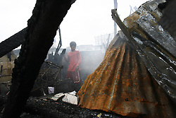 60643322 <br /> A resident looks for reusable materials after a fire hit a slum area in Makati City, the Philippines, Oct. 27, 2013. More than 500 shanties were razed in the fire, leaving 2,000 families homeless and two children killed, on Sunday, 27th October 2013. Picture by  imago / i-Images.<br /> UK ONLY