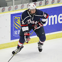COBOURG, - Dec 16, 2015 -  Game #7 - United States vs Switzerland at the 2015 World Junior A Challenge at the Cobourg Community Centre, ON. Andrew Peeke #9 of Team United States passes the puck during the first period.(Photo: Tim Bates / OJHL Images)