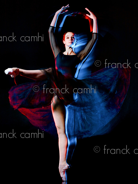 one caucasian woman ballerina classical ballet dancer dancing woman studio shot isolated on black bacground