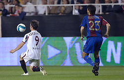 03-03-2007 VOETBAL: SEVILLA FC - BARCELONA: SEVILLA  <br /> Sevilla wint de topper met Barcelona met 2-1 / Alexander Kerzhakov en Oleguer - boarding unibet.com<br /> ©2006-WWW.FOTOHOOGENDOORN.NL