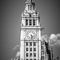 Chicago Wrigley Building clock black and white picture. The Wrigley Building is a Chicago skyscraper on Michigan Avenue and was built in 1920 by the Wrigley gum company. Photo is vertical and high resolution.