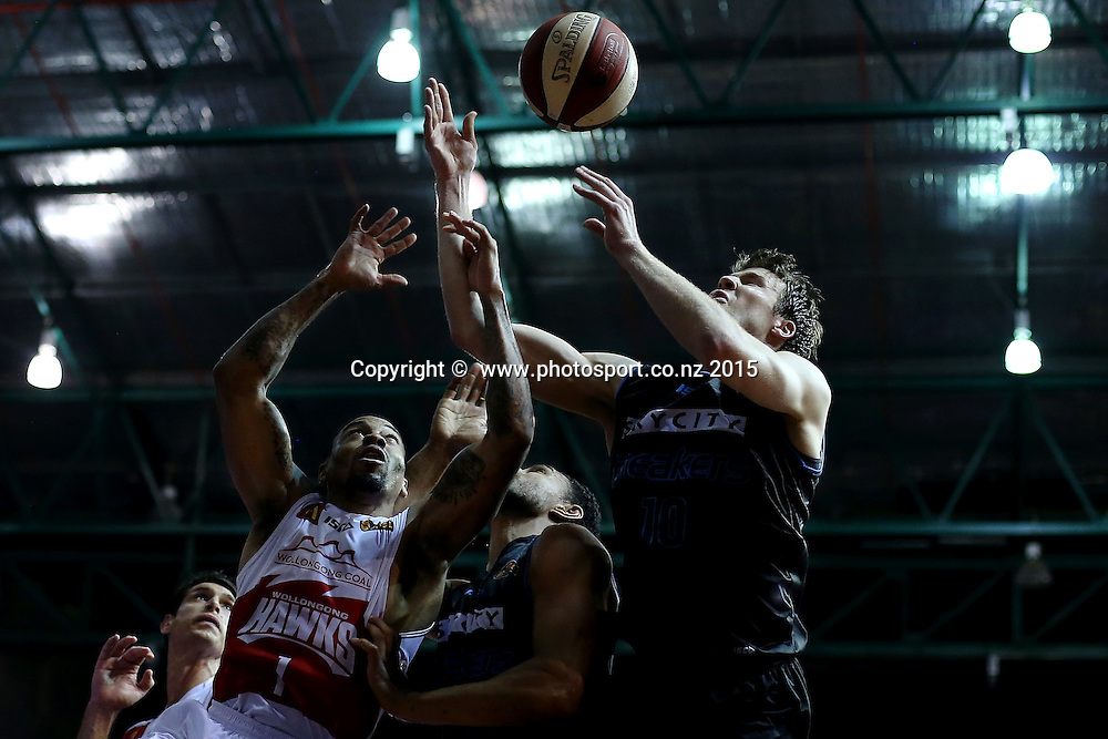 Tom Abercrombie of the Breakers competes for the rebound against Gary Ervin of the Hawks. 2014/15 ANBL, SkyCity Breakers vs Wollongong Hawks, North Shore Events Centre, Auckland, New Zealand. Thursday 8 January 2015. Photo: Anthony Au-Yeung / www.photosport.co.nz