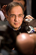 Sergio Marchionne, Managing Director of Fiat, speaks with journalists at First Quotation Cerimony of Fiat's two new divisions - Fiat Industrial and Fiat -  at Italian Stock Exchange, in Milan, Jan 3, 2011. © Carlo Cerchioli