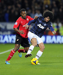 Cardiff City Midfielder, Kevin Theophile Catherine (FRA) battles for the ball with Man Utd Midfielder Marouane Fellaini (BEL) - Photo mandatory by-line: Joseph Meredith/JMP - Tel: Mobile: 07966 386802 - 24/11/2013 - SPORT - FOOTBALL - Cardiff City Stadium - Cardiff City v Manchester United - Barclays Premier League.