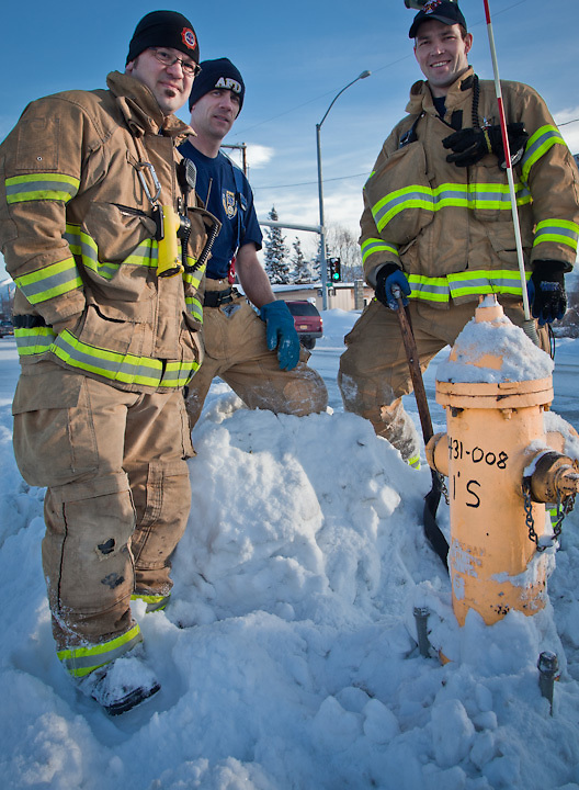 Anchorage Firemen, Paul Urbano, Andy Harvey, and Ryan Sorsdahl, shovel a fire hydrant on 15th Ave. near Cordova Street.
