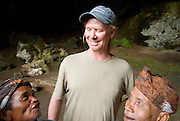 "The short people living near Liang Bua, Flores, would have stood head and shoulders above Homo floresiensis. 6' 2"" Joe Yaggi provides scale."