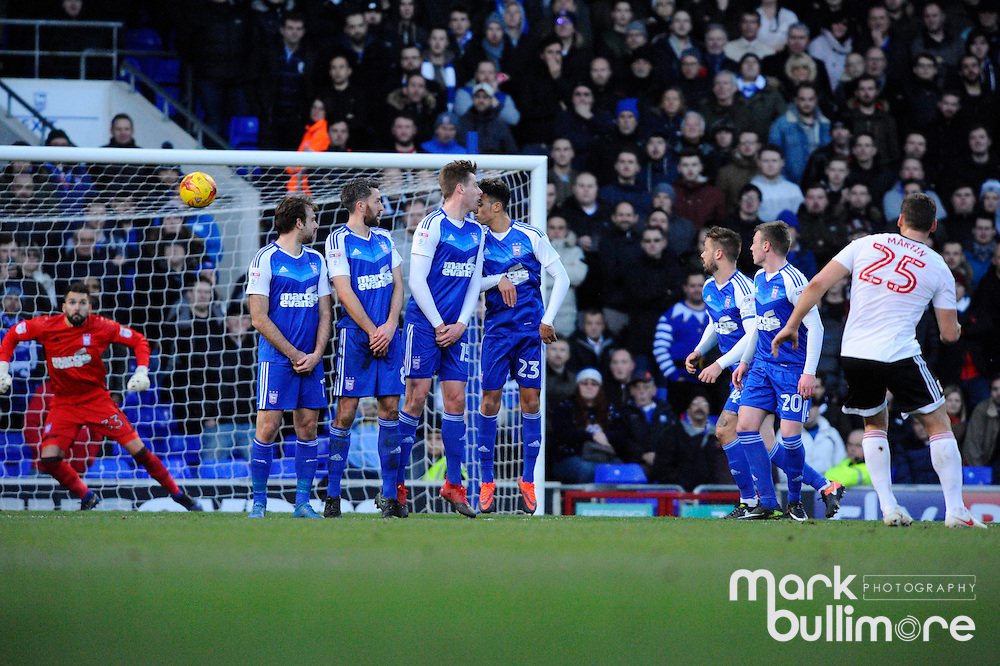 Ipswich, Suffolk. Football action from Ipswich Town v Fulham at Portman Road in the Sky Bet Championship on the 26th December 2016. Fulham's Chris Martin takes a penalty to beat Ipswich Goalkeeper Bartosz Bialkowski.<br /> <br /> Picture: MARK BULLIMORE