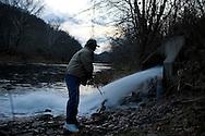 Water testing on Ten Mile Creek near a comer coal mine in Greene County, PA.  <br /> <br /> &copy;  Martha Rial 2011