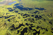 Kettle ponds decorate the landscape when flying over the edge of Cook Inlet on the way into Anchorage, Alaska.