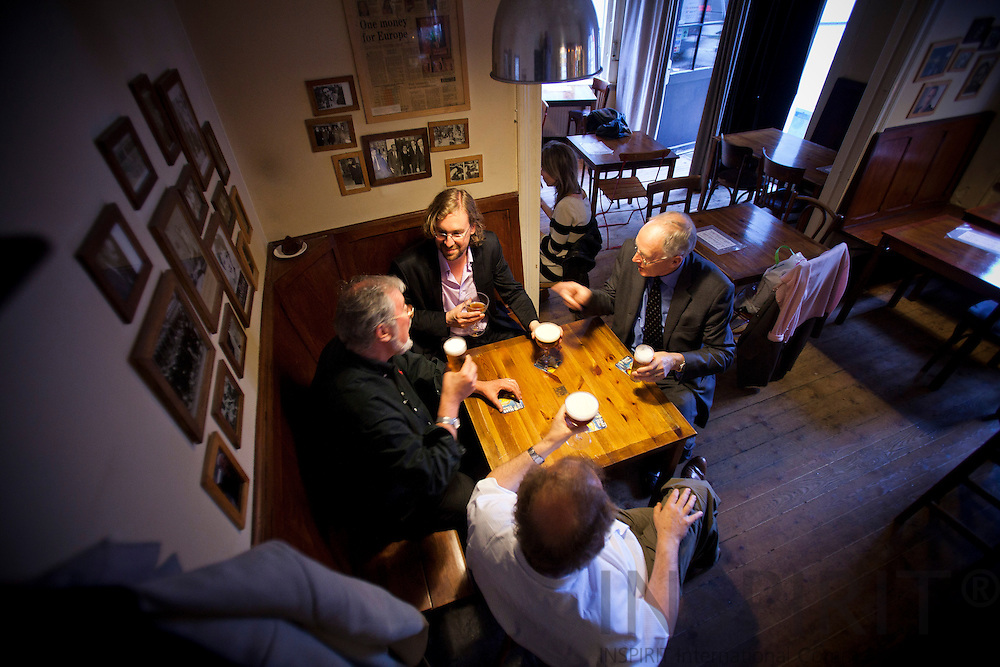 The most important and most wanted table in the middle of EU in Brussels is the corner table at the Old Hack Pub. Here the pub-keepers relax, eat and wait for the customers. Crosswords are filled out and articles written by journalists. Strategies planned by lobbyist. Discussions take place between EU functionaries, journalists, and lobbyist. Simply a meeting place for people from when the pub wakes up in the morning, the first guest sits at the table for lunch till the last one go home, when the landlady think it is enough and close for the night. Photo: Erik Luntang