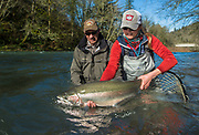 Guide Kate Taylor and The Captain show off a magniciant buck steelhead.