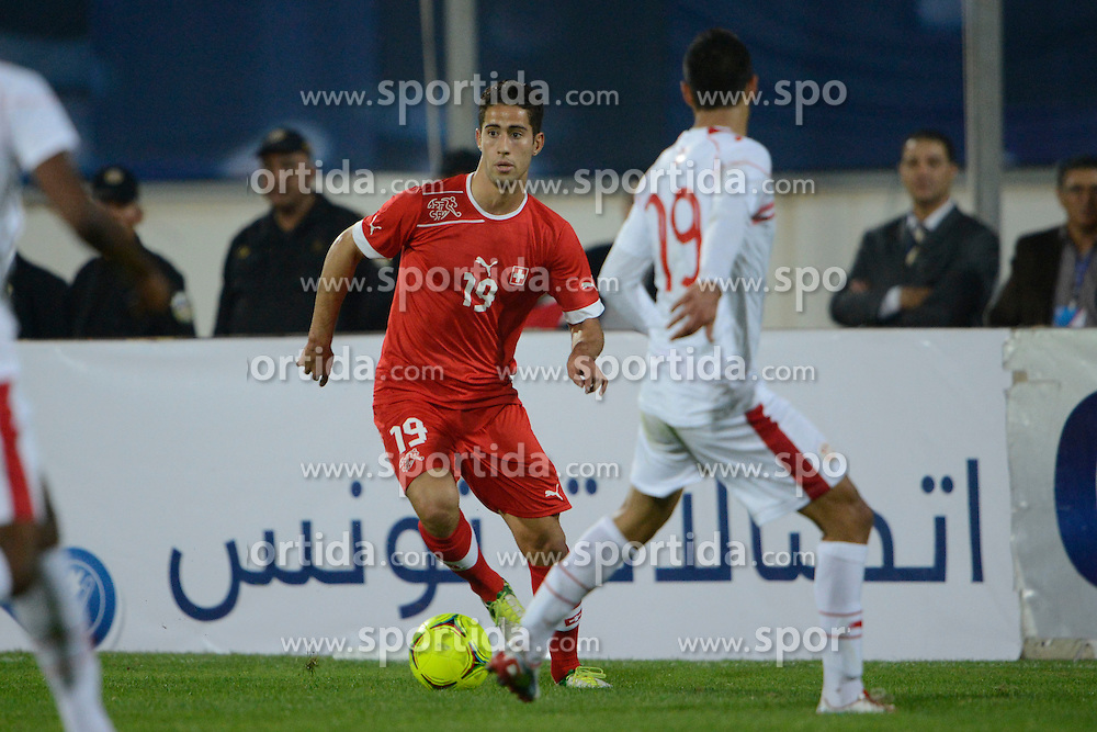 14.11.2012, Stade Olympique du Sousse, Sousse, TUN, Testspiel, Tunesien vs Schweiz, im Bild Nassim Ben Khalifa gegen Oueslati Abdelkad // during a international friendly match between Tunisia and Switzerlande at the Stade Olympique du Sousse, Tunisia on 2012/11/14. EXPA Pictures © 2012, PhotoCredit: EXPA/ Freshfocus/ Andreas Meier..***** ATTENTION - for AUT, SLO, CRO, SRB, BIH only *****