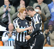 Steven Taylor (r) of Newcastle United celebrates the opening goal with Jack Colback  during the Barclays Premier League match at St. James's Park, Newcastle<br /> Picture by Simon Moore/Focus Images Ltd 07807 671782<br /> 01/01/2015