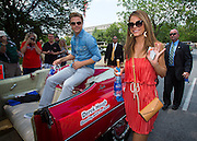 Derek Hough and Maria Menounos appear in the IPL 500 Festival Parade during Indy 500 activities in Indianapolis, IN.