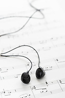 Black headphones on sheet music