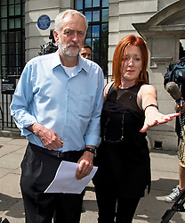 © London News Pictures. FILE PIC DATED 22/07/2015. . Labour leadership candidate JEREMY CORBYN MP being escorted from the Royal College of Nursing in London by his press officer CARMEL NOLAN after delivering a speech on the economy. Former Stop The War Coalition press officer CARMEL NOLAN has joined Jeremy Corbyn's team as a media advisor. Photo credit: Ben Cawthra/LNP