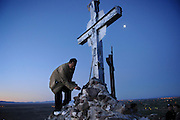 "pvc042211d/4-22-11/asec.  A short while before the day's first rays of sunlight, Joseph Ernest Barela (CQ), of Albuquerque, places a single long stemmed rose into the base of a cross at the peak of Tome Hill on Good Friday, photographed Friday April 22, 2011.  Barela said he is recovering from a cocaine and alcohol addiction, made the pilgrimage to Tome and said ""The only thing that's gonna keep me clean is Jesus and The Lord.""  (Pat Vasquez-Cunningham/Journal)"