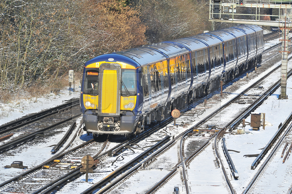 © Licensed to London News Pictures.28/02/2018<br /> Orpington, UK.<br /> Train Arriving from London.<br /> Train leaving for London in a haze of snow.<br /> A hand full of trains leaving Orpington Train Station in Kent for London as the snow causes travel chaos on the rails.<br /> More heavy snow overnight as the winter weather continues in Orpington, Kent.<br /> Photo credit: Grant Falvey/LNP