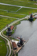 Nederland, Amsterdam, Zaandam, 25-05-2010. Molens aan oevers van rivier de Zaan, onderdeel van de Zaanse Schans. .Mills on the banks of the river Zaan, part of the Zaanse Schans..luchtfoto (toeslag), aerial photo (additional fee required).foto/photo Siebe Swart