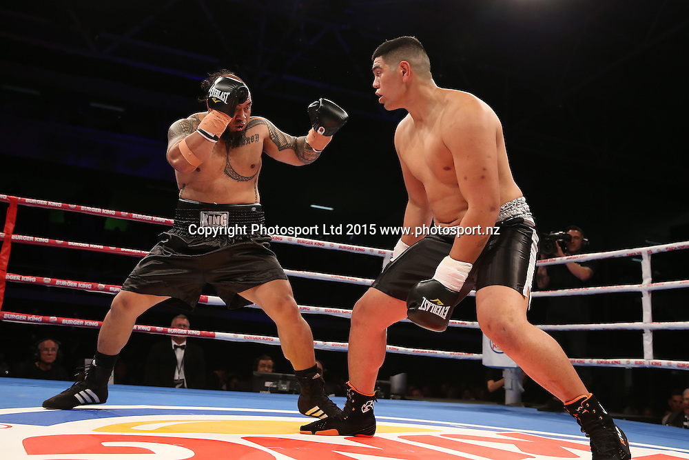 Willia Meehan (black and grey) fights Leamy Tato (in black) in bout two of the Road to the Title fight at Trusts Arena, Thursday, October 15, 2015. Photo: Fiona Goodall/photosport.nz