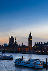 Westminster, London, February 2016. The sky is illuminated with delicate hues as the sun sets over the Houses of Parliament as forecasters predict another cold night. <br /> ///FOR LICENCING CONTACT: paul@pauldaveycreative.co.uk TEL:+44 (0) 7966 016 296 or +44 (0) 20 8969 6875. ©2015 Paul R Davey. All rights reserved.
