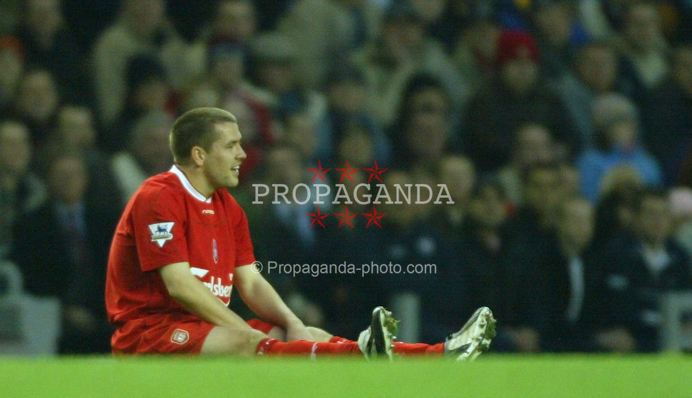LIVERPOOL, ENGLAND - Saturday, January 10, 2004: Liverpool's sits on the pitch frustrated against Aston Villa during the Premiership match at Anfield. (Photo by David Rawcliffe/Propaganda)