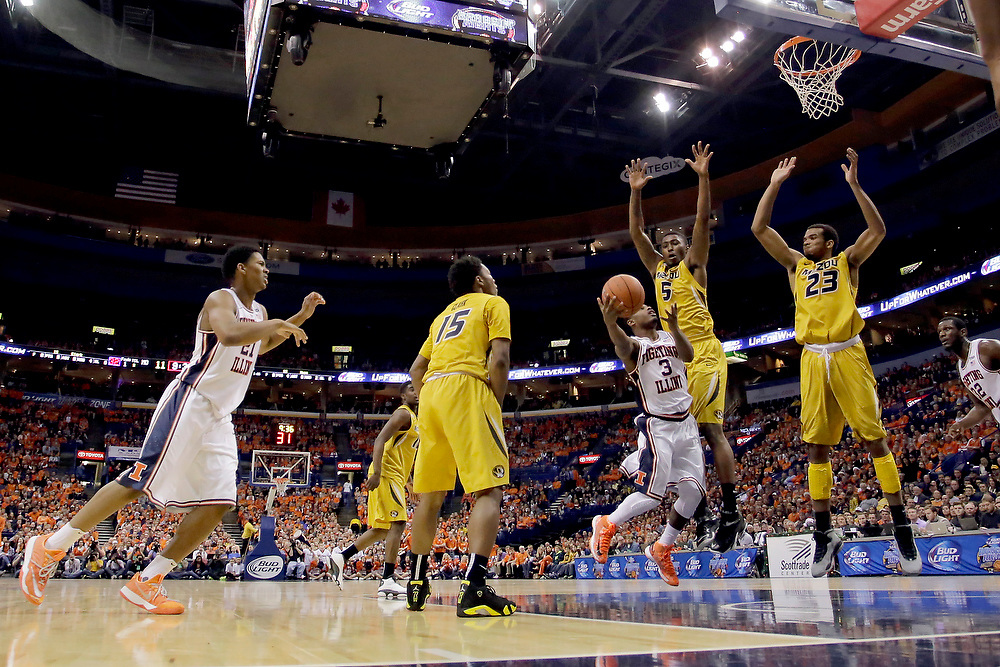 Illinois guard Ahmad Starks (3) shoots against Missouri forward D'Angelo Allen (5) and forward Jakeenan Gant (23) during the first half of the annual Braggin' Rights game at the Scottrade Center Saturday, Dec. 20, 2014, in St. Louis. (For the Herald & Review/ Stephen Haas)