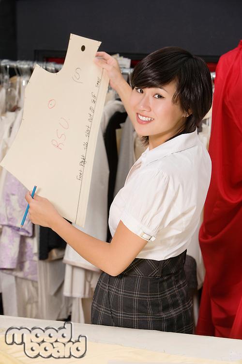 Fashion designer working in cloth design store