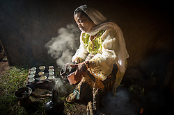 Ramla Sharif roasts coffee inside her home in the village of Choche in Ethiopia. Legend has it this is the birthplace of coffee. The region is home to the largest pool of genetic diversity in the world of coffee. It is home to more genetic diversity in coffee than the rest of the producing countries combined by a huge margin.