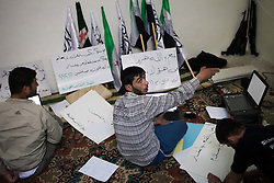 Syrian activists prepare slogans for a demonstration in one of their bases for friday where thousands of Syrians choose this day as a big day for demonstrations. Atareb, 30km west of Aleppo, on April 26, 2012. Photo by Daniel Leal-Olivas / i-Images...