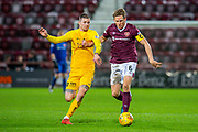 Christophe Berra (#6) of Heart of Midlothian FC attempts to run past Lyndon Dykes (#9) of Livingston FC during the Ladbrokes Scottish Premiership match between Heart of Midlothian FC and Livingston FC at Tynecastle Park, Edinburgh, Scotland on 4 December 2019.
