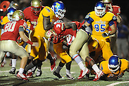 Lafayette High's Tay Tay Owens (3) is hit by Tupelo's Demarcus Rogers (12), Tupelo's Tyler Gilbert (36) and others in Oxford, Miss. on Friday, August 22, 2014. Tupelo won the season opener 20-0.