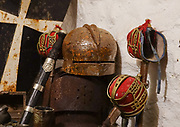 Medieval swords & helmet. Comlongon Castle is a restored Medieval Scottish tower house dating from the late 1400s. Guests can stay in the attached Edwardian hotel, a baronial style mansion built 1900-02, set in 120 acres of manicured gardens, sweeping lawns, carp pond, lakes and woodlands, near Clarencefield and Dumfries, in southwest Scotland, United Kingdom, Europe. Originally built by the Murrays of Cockpool, Comlongon Castle remained in the Murray family until 1984. The castle is 50 feet square and stands 70 feet high, with walls over 4 meters thick, with impressive displays of weapons, armor and banners.