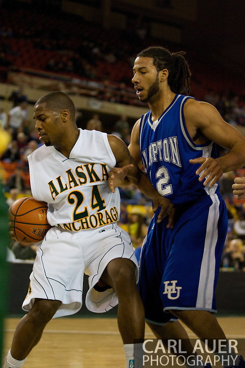 November 26, 2008: University of Alaska-Anchorage guard Kenny Barker (24) protects the ball from Hampton forward Theo Smalling (12) in the opening game of the 2008 Great Alaska Shootout at the Sullivan Arena against the University of Alaska-Anchorage Seawolves.