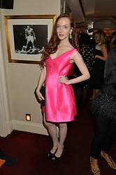 OLIVIA GRANT at a dinner hosted by fashion label Kate Spade NY held at George, 87-88 Mount Street, London on 19th November 2014.