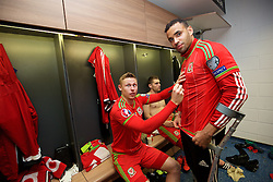 CARDIFF, WALES - Tuesday, October 13, 2015: Wales' Simon Church signs Hal Robson-Kanu's shirt in the dressing room after the 2-0 victory over Andorra during the UEFA Euro 2016 qualifying Group B match at the Cardiff City Stadium. (Pic by David Rawcliffe/Propaganda)