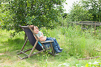 Mother sitting with son in garden