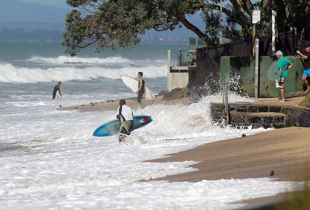 Surfers take to the waves caused by Cyclone Pam off Milford Beach on the Waitemata Harbour, Auckland, New Zealand, Monday, March 16, 2015. Credit:SNPA / Simon Runting