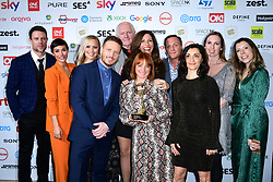 Wayne Bridge (left) and Frankie Bridge with the cast and crew of Emmerdale with the award for Best Soap at the TRIC Awards 2019 50th Birthday Celebration held at the Grosvenor House Hotel, London.