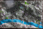 The shadows from a nearby tree cover a map of the capital's historical financial district (aka The Square Mile), on 5th October, 2017, in the City of London, England. The City was founded by the Romans as a trading centre in the 1st century AD and the shaded area largely reflects the ancient walled Roman city.