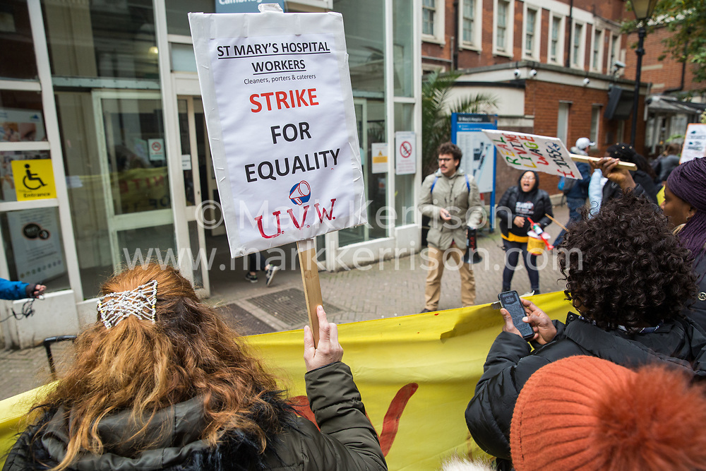 London, UK. 29 October, 2019. Outsourced workers belonging to the United Voices of the World (UVW) trade union stand on the picket line outside their workplace at St Mary's Hospital Paddington. Outsourced via Sodexo, one of the world's largest multinational corporations, around 200 migrant cleaners, porters and caterers are striking for equal pay, conditions and treatment with broadly equivalent NHS colleagues who are paid £6,000-10,000 p.a. more and have scheduled 12 days of strike action.