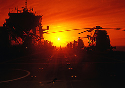 © licensed to London News Pictures. IRAQ . FILE PICTURE. Sunset onboard HMS Ocean 2004. Please see special instructions. Photo credit should read Andre Chittock/LNP.