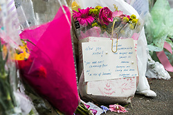"""© Licensed to London News Pictures. 28/03/2018. Liverpool, UK. A note reading """" Now you know! """" and """" You are not coming back as a tin of sardines """". Rows of flowers and tributes left outside Ken Dodd's lifetime home in Knotty Ash on the morning of the funeral of comedian and performer Sir Ken Dodd , who died on 11th March 2018 at the age of 90 . Photo credit: Joel Goodman/LNP"""